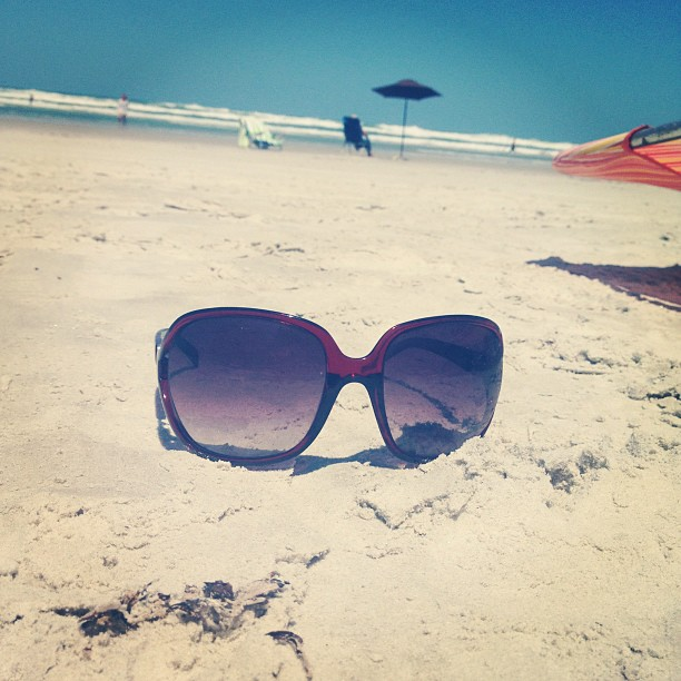 Sunglasses-in-Sand-at-Beach