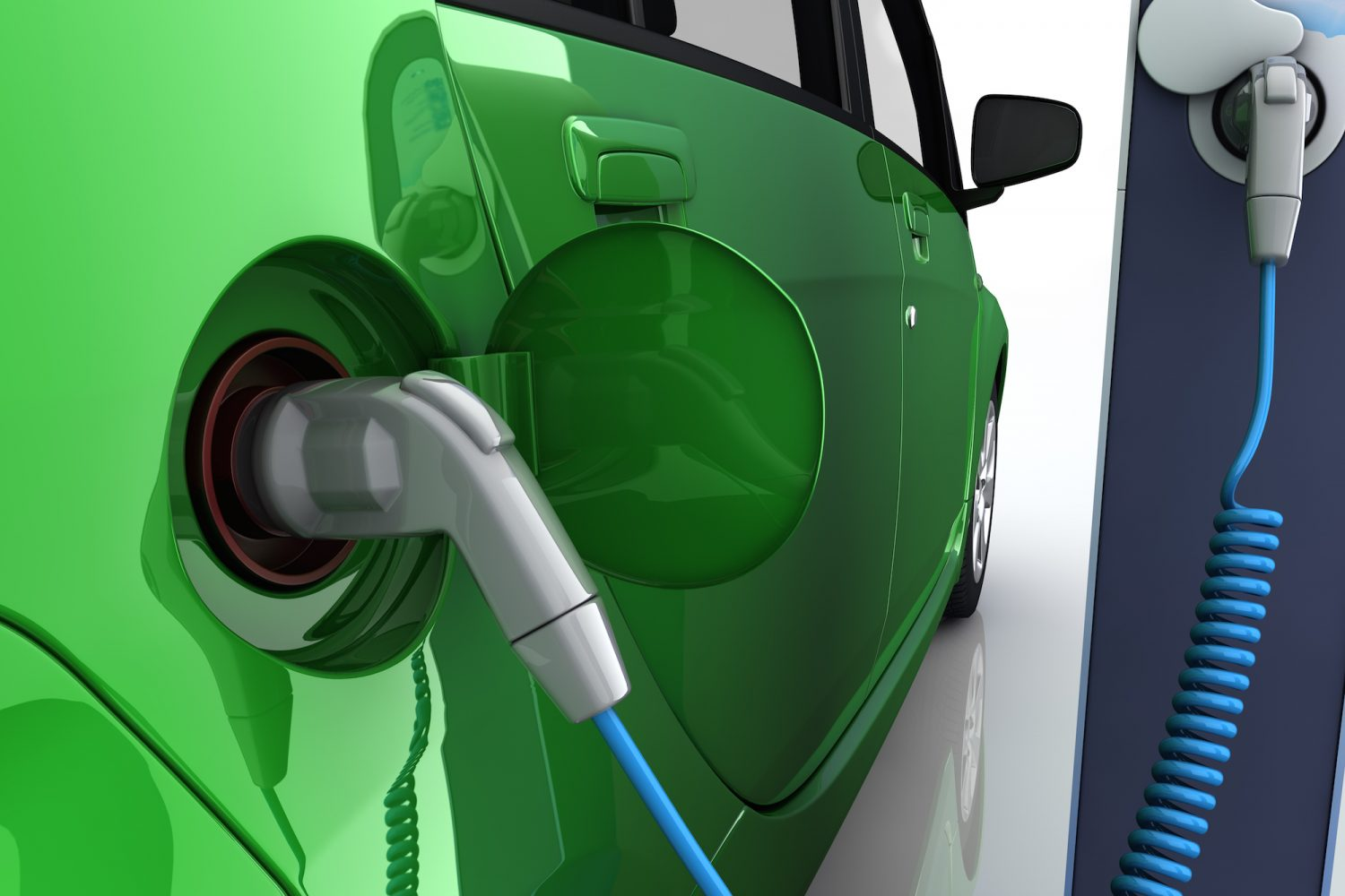 Green electric car at charging station with power outlet
