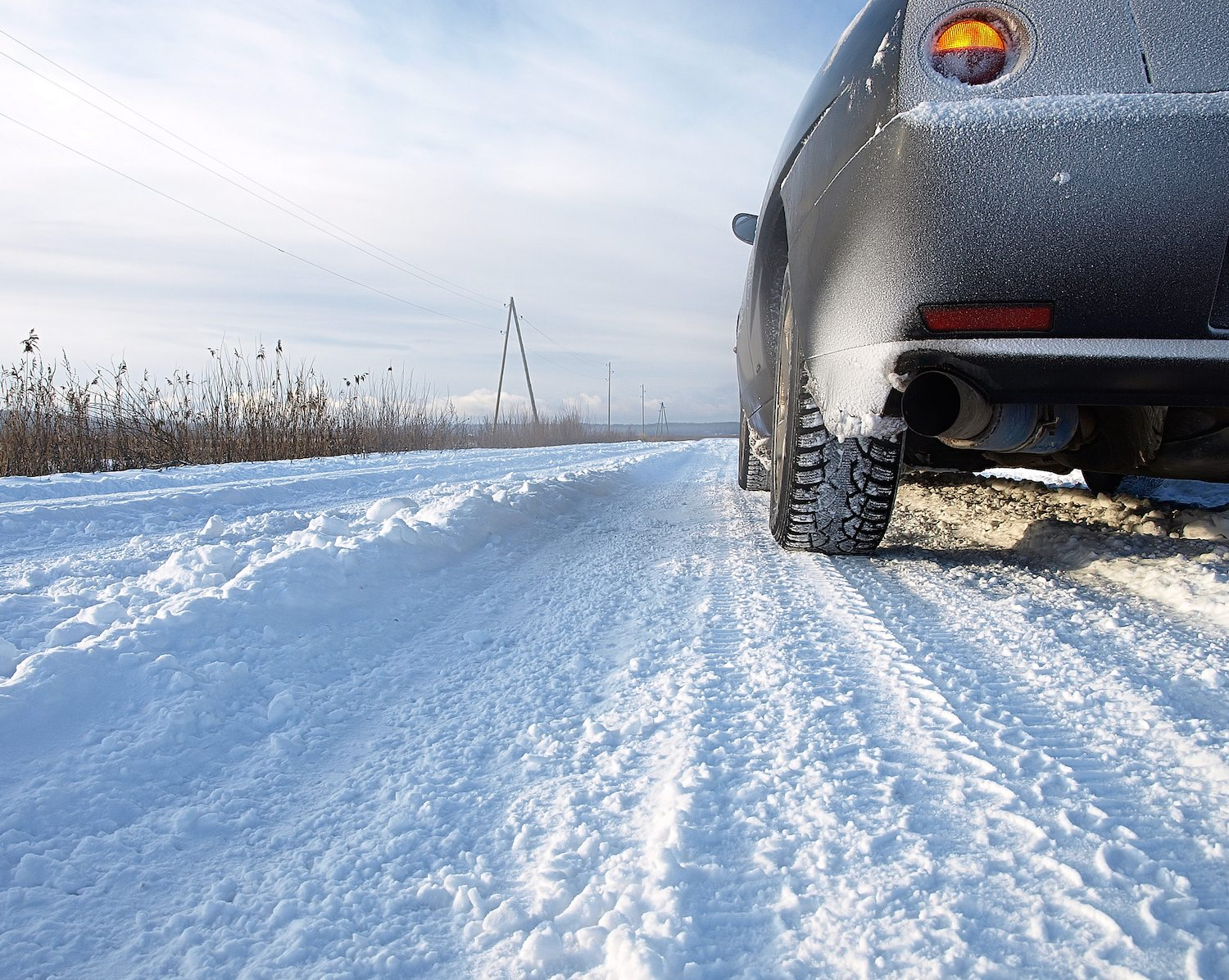Car On A Snowy Country Road