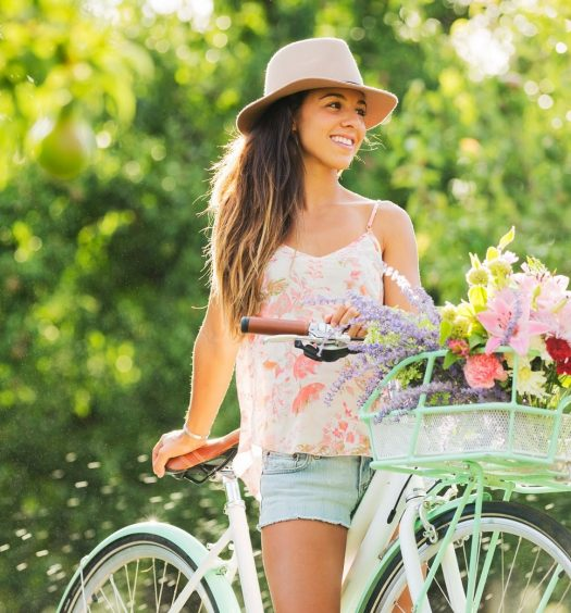 Girl on Bicycle in Spring With Flowers