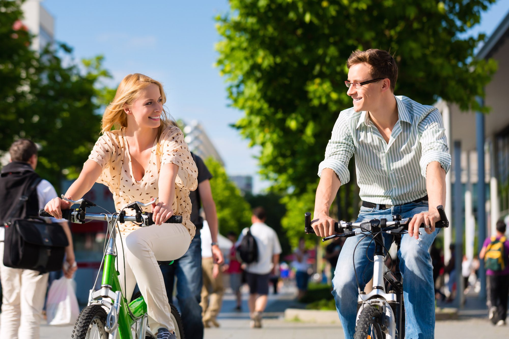 http://drivethenation.com/wp-content/uploads/2015/04/Bigstock-46026116-Couple-man-and-woman-riding-their-bikes-or-bicycles-in-their-free-time-and-having-fun-on-a-sunny.jpg