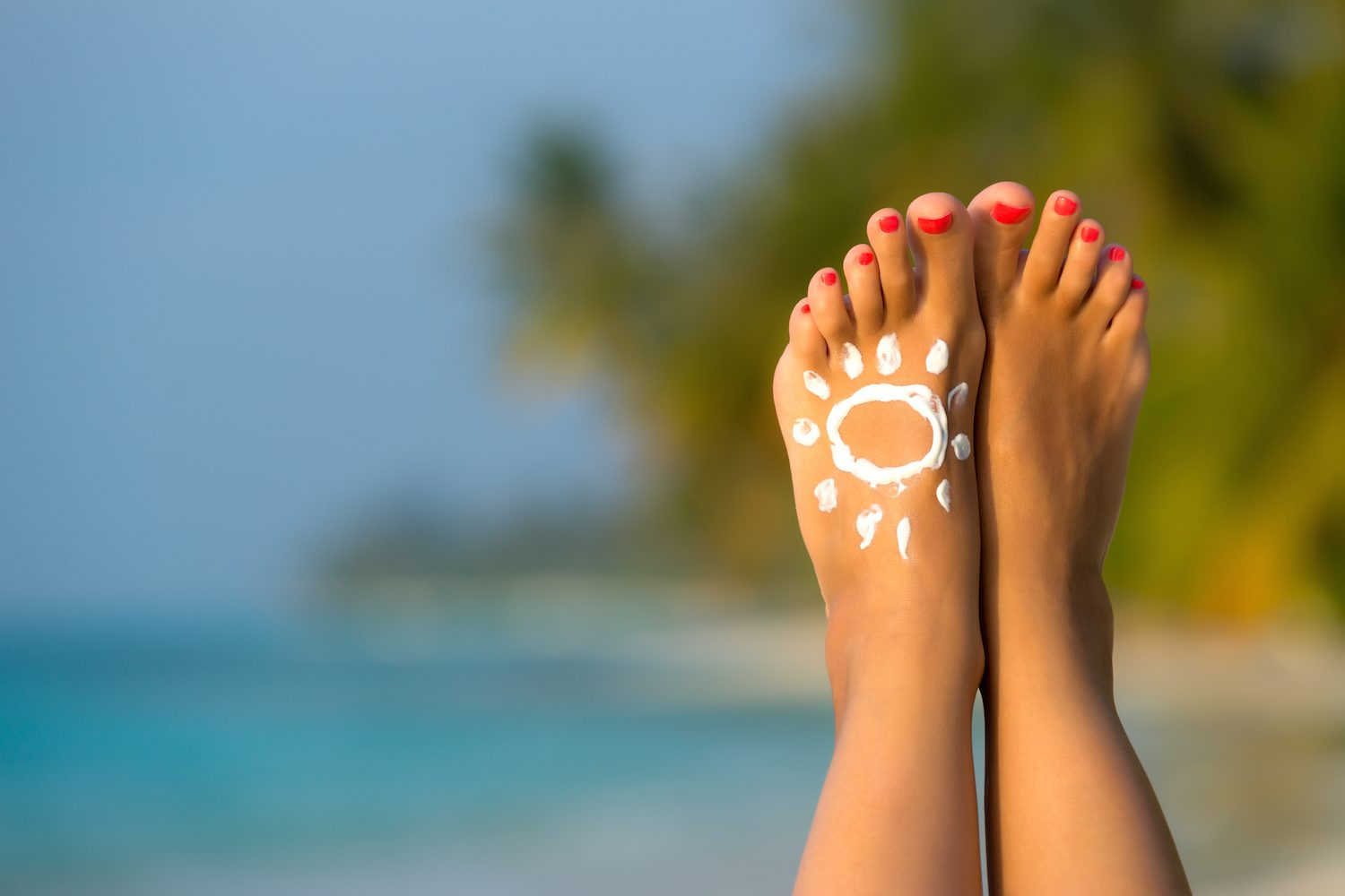 Woman's Foot With Sun-shaped Sunscreen