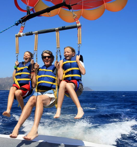 Father and Daughters Parasailing