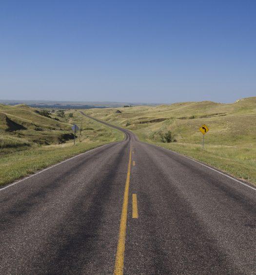 A highway traveling in the sandhills of Nebraska.