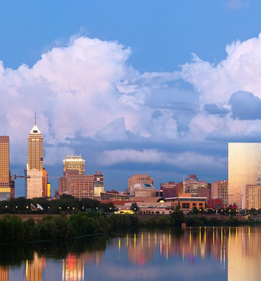 Image of Indianapolis skyline at sunset after thunderstorm.