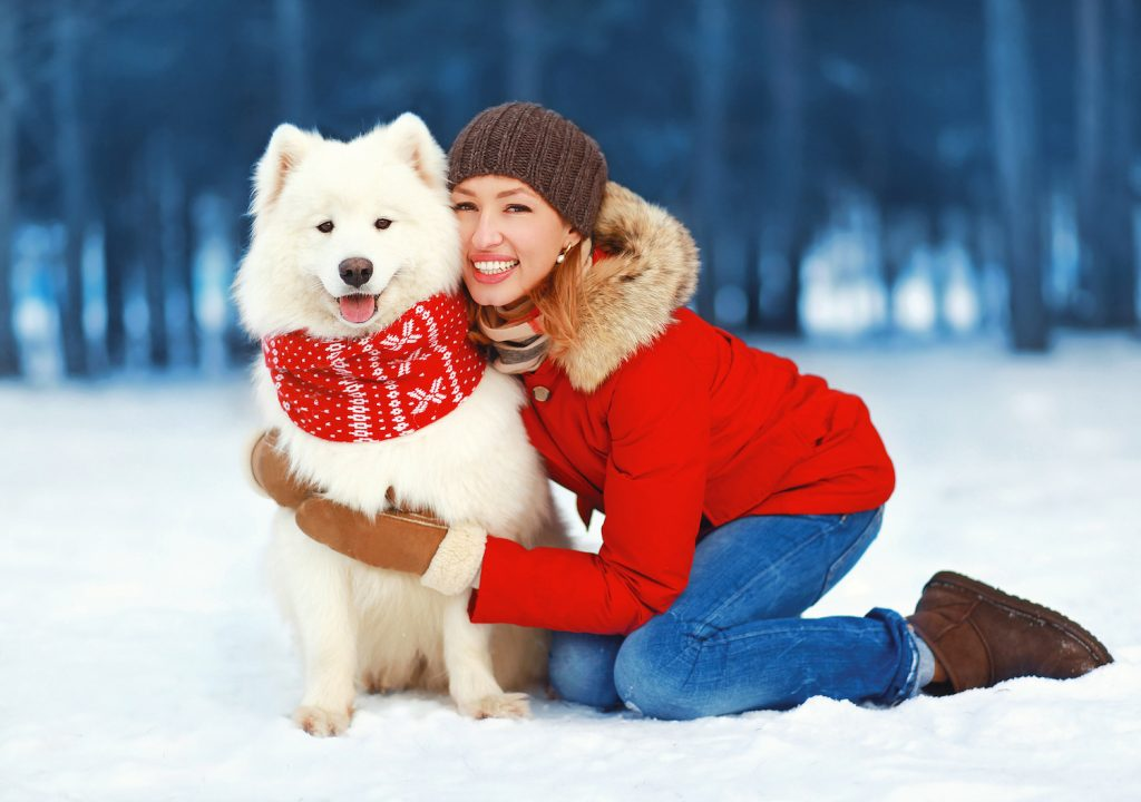 Woman With Dog in the Snow