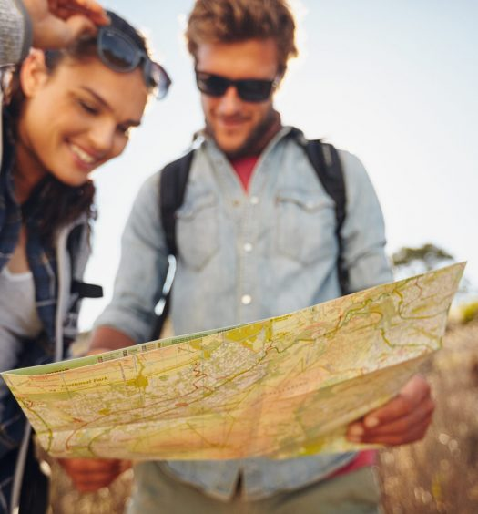 Traveling Couple Reading Map