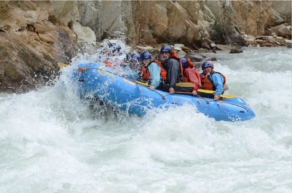 The author (right center) and his granddaughter Ava (left center) whitewater rafting on the Kicking Horse River. The author's wife is shrouded with spray to Ava's left. (Photo courtesy of Hydra River Guides)