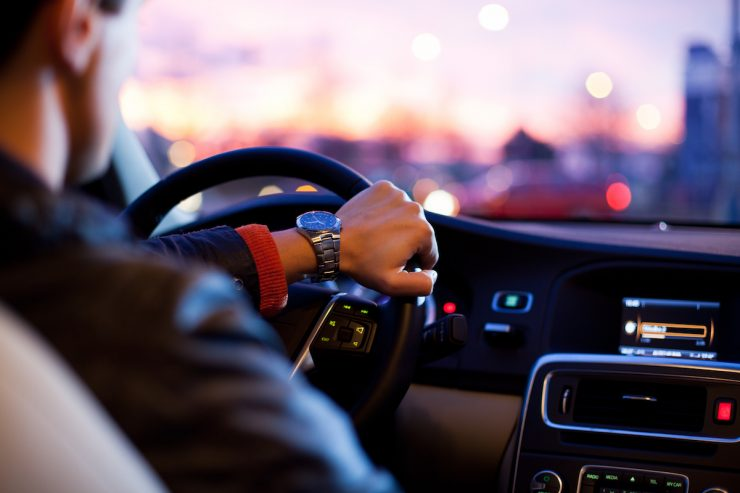 Man Driving with Watch