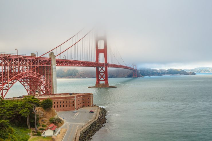 Aerial view of Golden Gate Bridge from Fort Point, south shore, symbol, icon and landmark of San Francisco, California, United States. Typical fog in summertime. Travel and holidays concept.