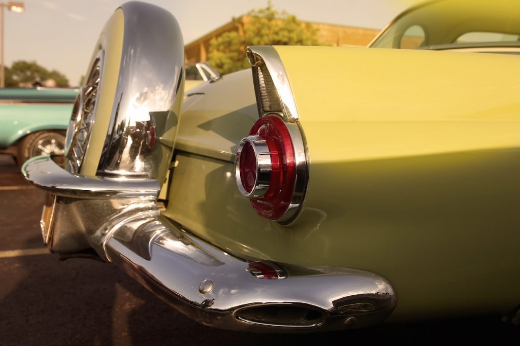 Close up of classic rear vintage yellow car