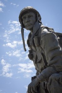 Outdoor Iron Mike statue depicting a WWII era Airborne trooper