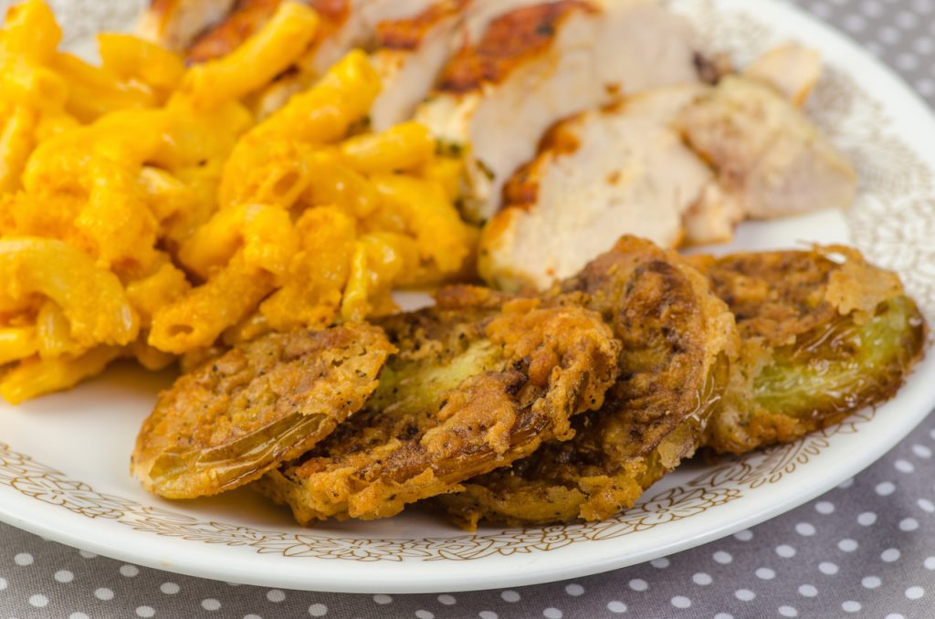 close up of plated fried green tomatoes, fried chicken and macaroni and cheese