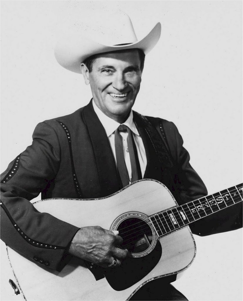 black and white photograph of country singer, Ernest Tubb, holding his guitar