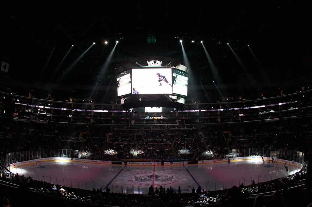 Staples Center Arena, lights dimmed, just before the start of a hockey game