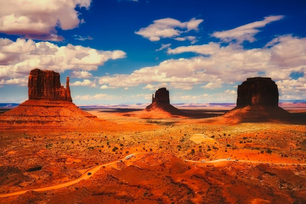 Monument Valley, Utah on a beautiful sunny day with hues of red and orange seen in the dunes
