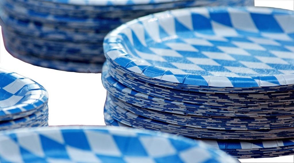 stacks of blue and white paper plates on a white background