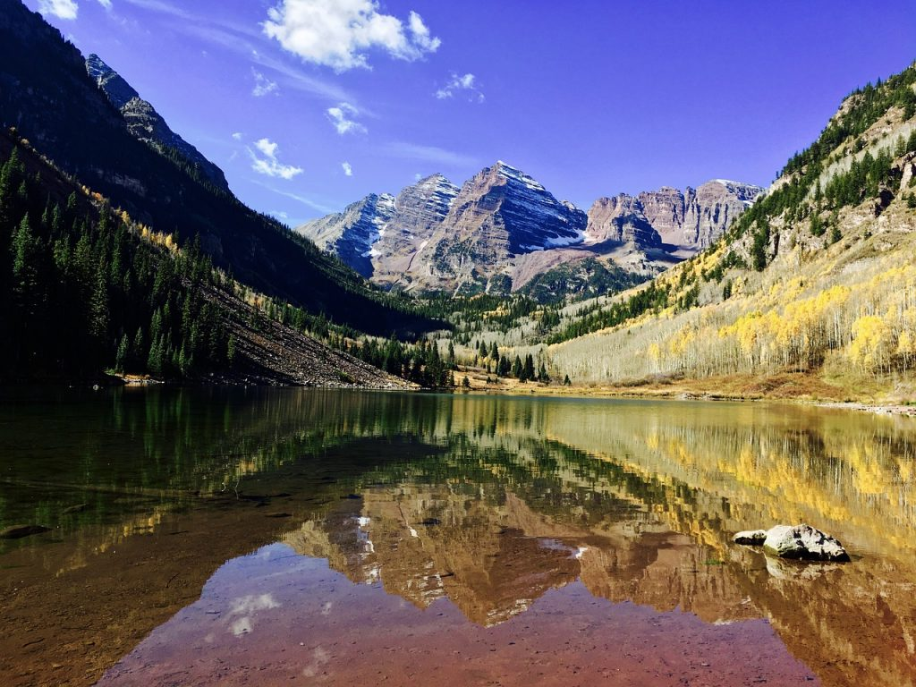 clear water view with mountains in the background in Aspen, Colorado